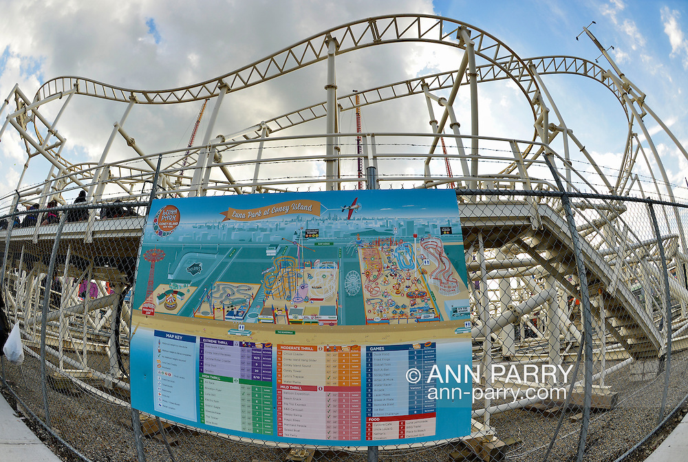Brooklyn, New York, USA. 10th August 2013. A big poster on the fence next to the Steeplechase ride, has colorful diagrams of the rides and games at Luna Park, plus information about each, during the 3rd Annual Coney Island History Day celebration.