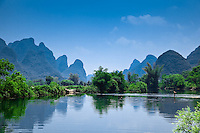 Man swimming in the Dragon River near Yangshuo.