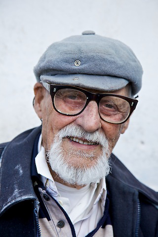 """Giorgos Stamulos, 102, lives in the mountains. He greet people who visit by singing songs, one of them say: """"I hadn't enough youth..."""""""