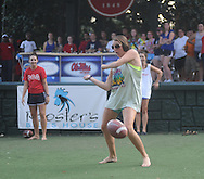 Students perform their version of a touchdown dance at an Ole Miss pep rally in the Grove in Oxford, Miss. on Thursday, September 1, 2011.