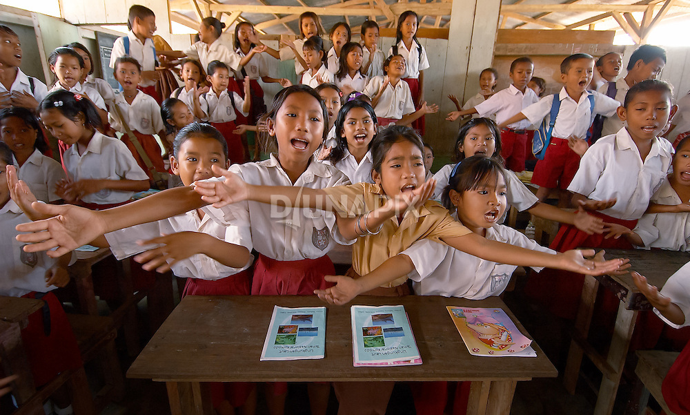 School girls enthusiastically sing during a Pride Campaign visit, Komodo Village, Komodo National Park