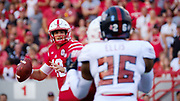 Lincoln, NE - Sept 2: Quarterback Tanner Lee #13 of the Nebraska Cornhuskers looks downfield during their game against the Arkansas State Red Wolves at Memorial Stadium in Lincoln Nebraska September 2 2017. Photo by Eric Francis