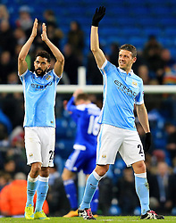 Martin Demichelis and Gael Clichy of Manchester City celebrate at full time - Mandatory byline: Matt McNulty/JMP - 15/03/2016 - FOOTBALL - Etihad Stadium - Manchester, England - Manchester City v Dynamo Kyiv - Champions League - Round of 16