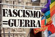 Placard reads Fascist = War and peace flag at demonstration of Liberation day in Milan, April 25, 2011. © Carlo Cerchioli..Un cartello recita Fascismo = Guerra alla manifestazione per la Liberazione, Milano 25 aprile 2011.