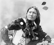 Native North American Indian warrior.   Photograph by Edward Curtis (1868-1952).