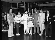 Vietnamese Refugees at Dublin Airport..1985..20.03.1985..03.20.1985..20th March 1985..After the Vietnam war,many European countries opened their doors to the dispossessed. The United Nations and several charities were to the forefront of the campaign to resettle some of the population away from the horrors of a war which had devastated large areas of Vietnam...Picture shows the Vietnamese refugees,(2nd from left),Pham Tri Thiy, Nguyen Tri Dung and Pham Thi Thao as they are met by some of their relations..