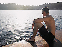 Man Sitting by Water