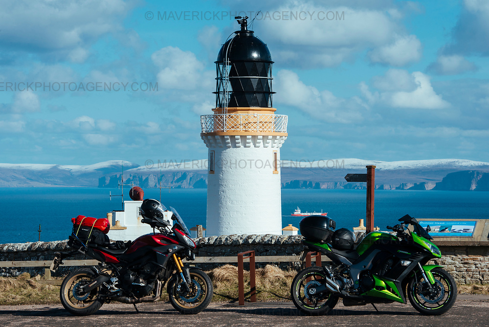 CAITHNESS, UK - April 2018:  Dubbed Scotland's Route 66, The North Coast 500 is a 516-mile (830 km) scenic route around the north coast of Scotland. Running through the traditional counties of Inverness-shire, Ross and Cromarty, Sutherland and Caithness, the route starts at Inverness and runs via Muir of Ord, Applecross (including the notorious Bealach na Bà), Gairloch, Ullapool, Durness, Thurso, John o'Groats, Wick, Dunrobin Castle, Dingwall then finally back to Muir of Ord and Inverness.  Pictured Dunnet Head, the most northerly point of mainland Britain.