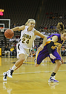 December 22 2010: Iowa guard Jaime Printy (24) drives past Northern Iowa guard Jacqui Kalin (10) during the first half of an NCAA college basketball game at Carver-Hawkeye Arena in Iowa City, Iowa on December 22, 2010. Iowa defeated Northern Iowa 75-64.