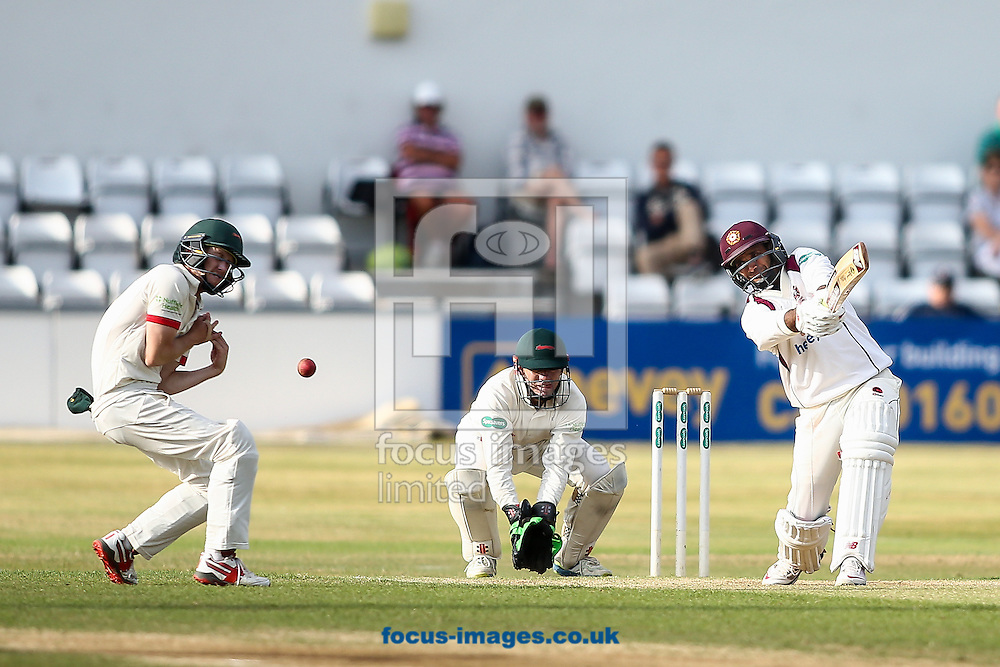 Muhammad Azhar Ullah of Northamptonshire CCC (right) hits the ball to the boundary for four during the Specsavers County C'ship Div Two match at the County Ground, Northampton<br /> Picture by Andy Kearns/Focus Images Ltd 0781 864 4264<br /> 14/08/2016