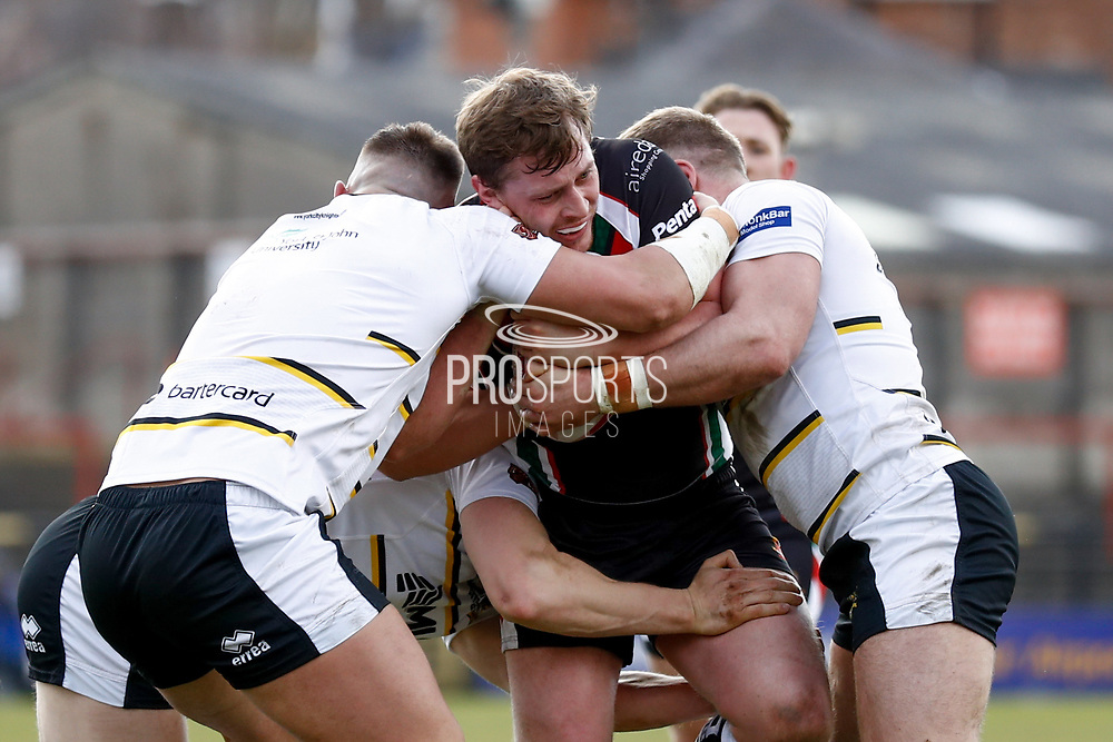 Keighley Cougars prop Matthew Bailey (19) is held in the tackle during the Betfred League 1 match between York City Knights and Keighley Cougars at Bootham Crescent, York, England on 25 March 2018. Picture by Simon Davies.