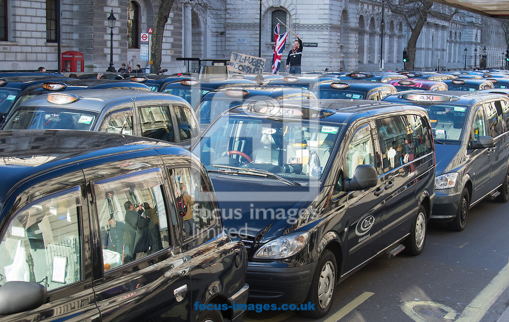 A taxi driver waves a Union Jack as an estimated 8,000 cabbies protest against &quot;unfair competition&quot; from Uber mini cabs<br /> Picture by Paul Davey/Focus Images Ltd +447966 016296<br /> 10/02/2016