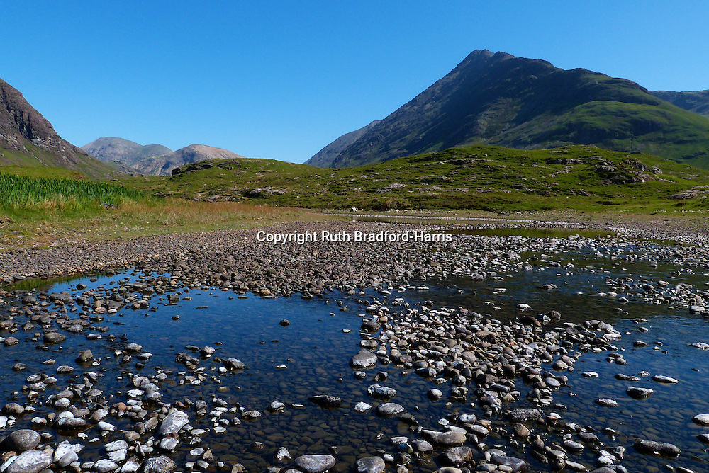 Pebbles in the stream Abhainn Camas Fhionnairigh at leading to the beach at Camasunary, Isle of Skye.<br />