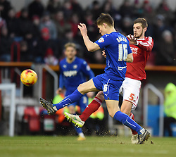Chesterfield's Charlie Raglan stops an attack by Swindon Town's Jack Stephens in the Sky Bet League One match between Swindon Town and Chesterfield at The County Ground on January 17, 2015 in Swindon, England. - Photo mandatory by-line: Paul Knight/JMP - Mobile: 07966 386802 - 17/01/2015 - SPORT - Football - Swindon - The County Ground - Swindon Town v Chesterfield - Sky Bet League One