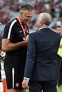 February 18, 2017:  Sydney FC coach Graham Arnold and Western Sydney Wanderers goalkeeping coach Zeljko KALAC shake hands before the game at Round 20 of the 2016 Hyundai A-League match, between Western Sydney Wanderers and Sydney FC, played at ANZ Stadium in Sydney.