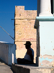 MALTA WIED IZ ZURRIEQ 23JUL06 - A Maltese man sits in the afternoon shade near the Knight's tower...jre/Photo by Jiri Rezac..© Jiri Rezac 2006..Contact: +44 (0) 7050 110 417.Mobile:  +44 (0) 7801 337 683.Office:  +44 (0) 20 8968 9635..Email:   jiri@jirirezac.com.Web:    www.jirirezac.com