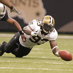 2008 October, 12: New Orleans Saints defensive end Bobby McCray (93) dives for a loose ball during the second half of a week six regular season game between the Oakland Raiders and the New Orleans Saints at the Louisiana Superdome in New Orleans, LA.