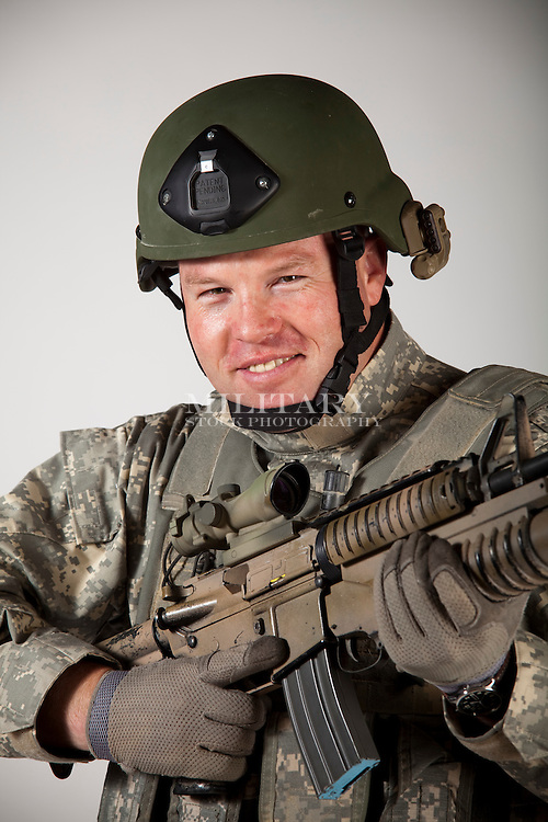 "SOLDIER OR MARINE INFANTRYMAN, MODEL-RELEASED.  This photograph complies with some US DOD requirements for use in advertising and promotion.  The man is an actor, not an active-duty member of any US DoD agency.  Some image editing may be required to remove US-specific insignia...MILITARY STOCK PHOTOGRAPHY - STOCKPHOTO.US TERMS AND CONDITIONS.A. Definitions: ""Photographer"" refers to Hans Halberstadt/Military Stock Photography or StockPhoto.US. ""Client"" refers to the party licensing the photograph or photographs. If the party is acting as an agent for a principal to whom the license is granted for the benefit of, then the principal is a ""Client"" in addition to the agent. The agent warrants that such principal has authorized the agent to enter into this agreement on the principal's behalf..B. Payment: Full payment must be received by Photographer prior to publication. Any use prior to payment shall be considered an unauthorized use and subject to the remedies set forth in paragraph H..C. Grant of Rights: Grant of reproduction rights hereunder is conditioned upon Client's written acceptance of each term set forth in this agreement. Such rights are provided on a nonexclusive and nontransferable basis. Client agrees to limit its use of licensed photographs to the use, medium, time period, print run, placement, image size, territory, and other restrictions specified in the invoice. Unless otherwise stated, the duration of license is six times the periodicity of the publication or 90 days which ever comes first. Client may not assign or transfer this license to any other person..D. Client Terms and Conditions: Military Stock Photo and StockPhoto.US do not accept Client Terms or Conditions..E. Return of Photographs, Destruction of Digital files, and Return of Media: Client assumes all risk for all photographic material supplied by Photographer from time of receipt by Client to time of actual receipt of photographs by Photographer. Client agrees to return all such material in"