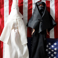 A KKK member and a religious woman in full cover meet in the woods. What is their conversation?