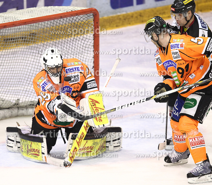 19.02.2013, Eisstadion Liebenau, Graz, AUT, EBEL, Graz 99ers vs UPC Vienna Capitals, 9. Platzierungsrunde, im Bild Frederic Cloutier (99ers, #29) und Dustin VanBallegooie (99ers, #5)// during the Erste Bank Icehockey League 9th Placement round match betweeen Graz 99ers and UPC Vienna Capitals at the Icehockey Stadium Liebenau, Graz, Austria on 2013/02/19. EXPA Pictures © 2013, PhotoCredit: EXPA/ Patrick Leuk