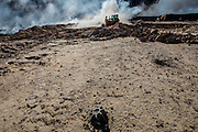 An unexploded mortar lies close to the firefighting efforts underscoring the danger facing the firefighters everyday. Qayyara, Iraq. Nov. 23, 2016. (Photo by Gabriel Romero ©2016)