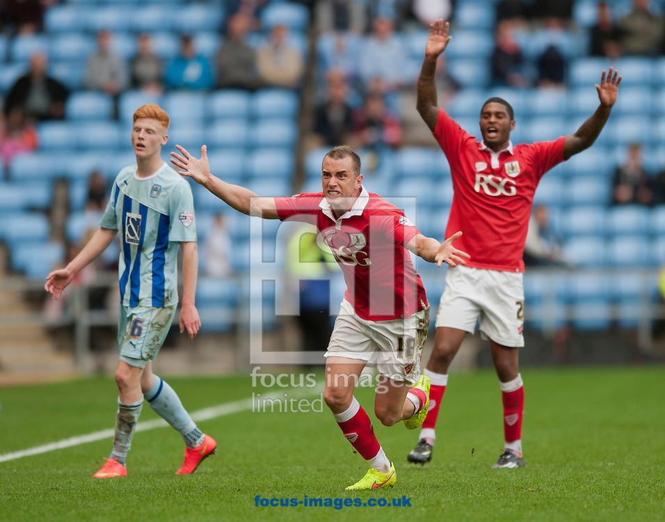 Aaron Wilbraham of Bristol City argues with the referee's assistant during the Sky Bet League 1 match at the Ricoh Arena, Coventry<br /> Picture by Russell Hart/Focus Images Ltd 07791 688 420<br /> 18/10/2014