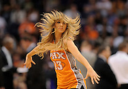 Mar. 14, 2012; Phoenix, AZ, USA; Phoenix Suns cheerleader performs during a time out at the US Airways Center. The Suns defeated the Jazz 120-111. Mandatory Credit: Jennifer Stewart-US PRESSWIRE..