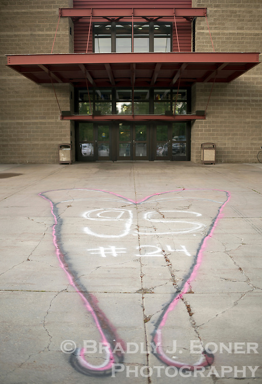 An impromptu mural in memoriam of Jackson Hole High School freshman Georgia Smits is painted on the sidewalk outside Jackson Hole High School last week. Smits was killed in an ATV accident in Colorado over the Memorial Day weekend.