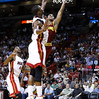 24 January 2012: Cleveland Cavaliers point guard Ramon Sessions (3) goes for the layup past Miami Heat power forward Chris Bosh (1) during the Miami Heat 92-85 victory over the Cleveland Cavaliers at the AmericanAirlines Arena, Miami, Florida, USA.