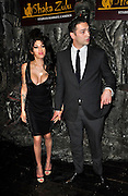 04.AUGUST.2010 - LONDON<br /> <br /> AMY WINEHOUSE AND BOYFRIEND REG TRAVISS ATTEND THE LAUNCH PARTY FOR NEW BAR SHAKA ZULU IN THE STABLES MARKET, CHALK FARM.<br /> <br /> AMY WINEHOUSE, 27 WAS FOUND DEAD AT HER LONDON FLAT. THE SINGER WAS APPARENTLY FOUND AT 4PM AND HER DEATH IS BELIEVED TO BE UNEXPLAINED.<br /> <br /> BYLINE MUST READ: EDBIMAGEARCHIVE.COM<br /> <br /> *THIS IMAGE IS STRICTLY FOR UK NEWSPAPERS AND MAGAZINES ONLY*<br /> *FOR WORLDWIDE SALES AND WEB USE PLEASE CONTACT EDBIMAGEARCHIVE - 0208 954 5968*