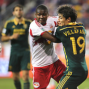 Chris Duvall, (left), New York Red Bulls and Jorge Villafana, Portland Timbers, tussle for the ball during the New York Red Bulls Vs Portland Timbers, Major League Soccer regular season match at Red Bull Arena, Harrison, New Jersey. USA. 24th May 2014. Photo Tim Clayton