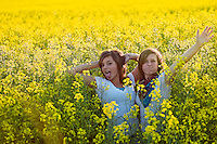 Makayla Franks and Felicia Pollos goof off on in the tall flowers on the Rathdrum Prairie during a trip Friday, July 9, 2010.