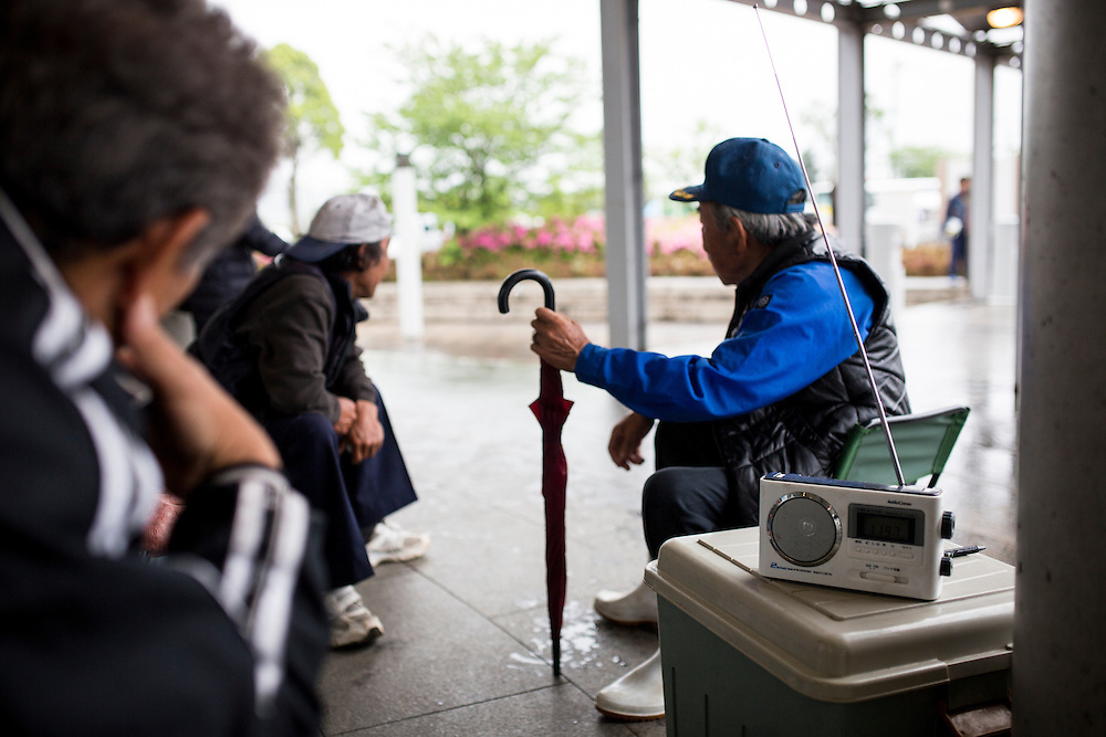 KUMAMOTO, JAPAN - APRIL 21:  Survivors listen to radio transistor in the morning of April 21, 2016 in Mashiki Gymnasium evacuation center, Kumamoto, Japan. To date 45 people are confirmed dead and around 11,000 people have evacuated after an 6.5 earthquake on Thursday night and a stronger 7.3 quake on Saturday morning struck the Kyushu Island in western Japan.<br /> <br /> Photo: Richard Atrero de Guzman