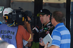 June 25, 2011; Sonoma, CA, USA;  NASCAR Sprint Cup Series driver Carl Edwards (center) is interviewed in the garage area during practice for the Toyota/Save Mart 350 at Infineon Raceway.