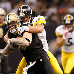 Oct 31, 2010; New Orleans, LA, USA; New Orleans Saints tight end Jeremy Shockey (88) is tackled by Pittsburgh Steelers safety Troy Polamalu (43) during the second half at the Louisiana Superdome. The Saints defeated the Steelers 20-10.  Mandatory Credit: Derick E. Hingle..