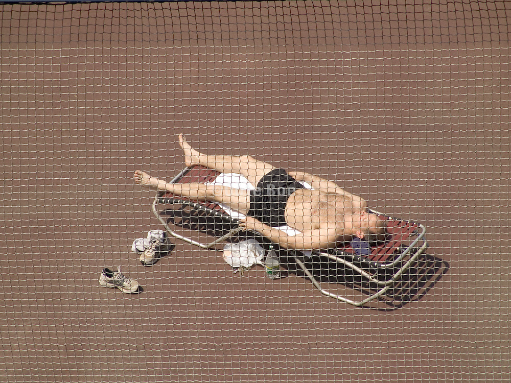 man sunbathing on rooftop