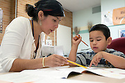 Seattle, Washington: June 14, 2012. Bilingual Latino student entering kindergarten, takes English language assessment test, since his native language is Spanish, at the Seattle World School Family Counseling office.
