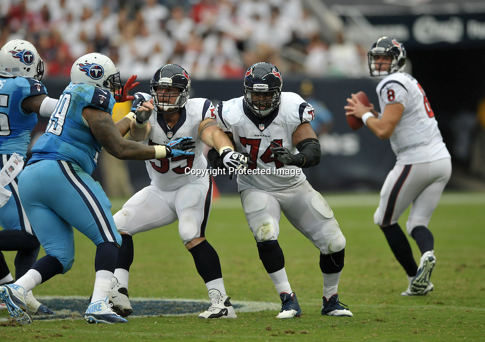 September 15 2013: Texans linemen Chris Myers(left) and  Wade Smith(74) block during 30 - 24 win over the Tennessee Titans at Reliant Stadium in Houston, TX.