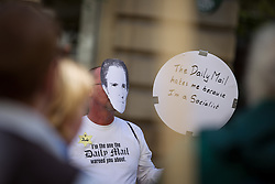 "© Licensed to London News Pictures . 06/10/2013 . Manchester , UK . A man wearing a Ralph Miliband face mask , a gold star with "" Jude "" written on it , a t-shirt that reads "" I'm the one the Daily Mail warned you about "" and carrying a placard that reads "" The Daily Mail hates me because I'm a Socialist "" . A demonstration against the Daily Mail newspaper in central Manchester's St Anne's Square today (6th October 2013) . Photo credit : Joel Goodman/LNP"