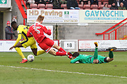 Mohamed Eisa if brought down by Josh Yorworth and Glenn Morris for the penalty during the EFL Sky Bet League 2 match between Crawley Town and Cheltenham Town at the Checkatrade.com Stadium, Crawley, England on 24 March 2018. Picture by Antony Thompson.
