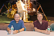 L-R, former NASA Apollo astronauts FRED HAISE and WALTER CUNNINGHAM are at a Summer of '69 Celebration Event held at the Long Island Cradle of Aviation Museum, on the 45th Anniversary of NASA Apollo 11 LEM, Lunar Excursion Module, landing on the moon July 20, 1969. Haise, the lunar module pilot for Apollo 13 mission and Cunningham the lunar module pilot for the Apollo 7 mission were in the LEM Room during the reunion of former Northrop Grumman Aerospace Corporation employees. Behind them is Lunar Module LM-13 intended for Apollo 18 mission to Copernicus Crater in 1973, which was canceled.