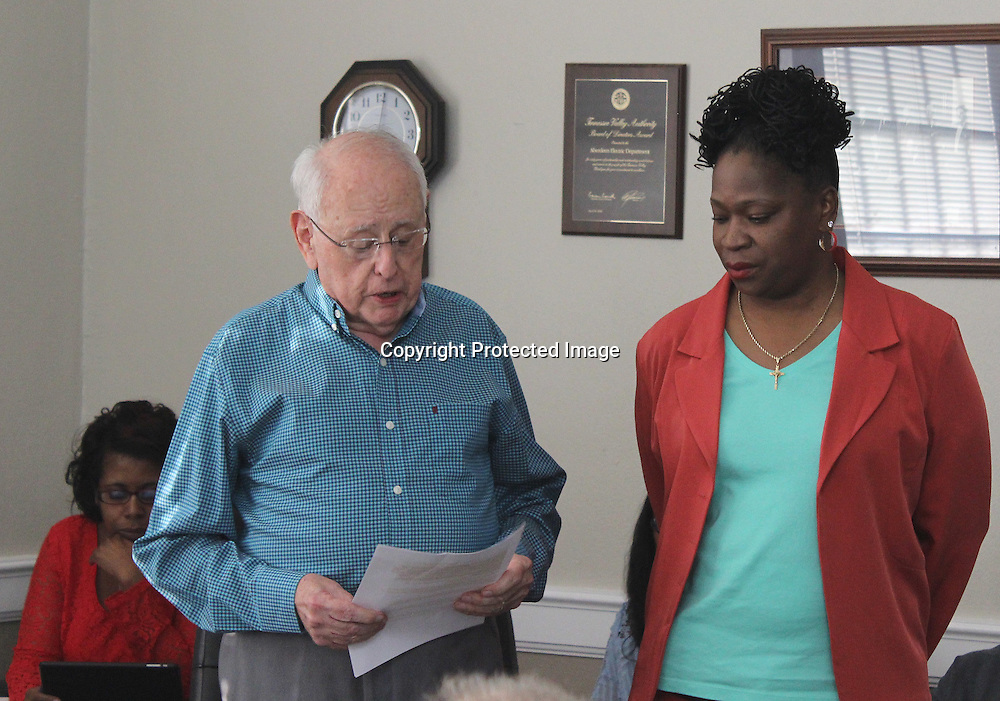 RAY VAN DUSEN/BUY AT PHOTOS.MONROECOUNTYJOURNAL.COM<br /> Ward 5 Alderman Jim Buffington reads acknowledgements of Aberdeen Housing Authority Director Denise Dobbs, right, during the Nov. 1 board of aldermen meeting. Dobbs was recognized for her leadership in turning the housing authority from what was considered sub-standard to now being high performing.