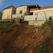 OCTOBER 13 - UTUADO, PUERTO RICO - <br /> Nailed Collazo, 63, stands on the backyard of her hurricane damaged house in Utuado's Sabana Grande neighborhood.<br /> (Photo by Angel Valentin/Freelance)