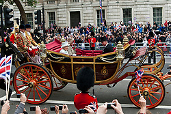 © Licensed to London News Pictures. 05/06/2012. London, UK. Queen Elizabeth II is seen riding in the State Landau coach with the Duke and Duchess of Cornwall along Whitehall past the Cenotaph, as part of the Jubilee Procession from Westminster Hall to Buckingham Palace. The Royal Jubilee celebrations. Great Britain is celebrating the 60th  anniversary of the countries Monarch HRH Queen Elizabeth II accession to the throne this weekend Photo credit :James Gourley/LNP