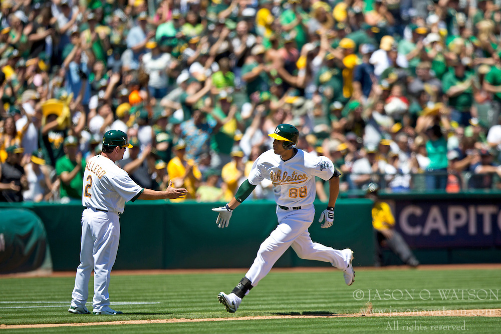 OAKLAND, CA - MAY 26:  Kyle Blanks #88 of the Oakland Athletics is congratulated by third base coach Mike Gallego #2 after hitting a home run off of Drew Smyly #33 of the Detroit Tigers (not pictured) during the second inning at O.co Coliseum on May 26, 2014 in Oakland, California. (Photo by Jason O. Watson/Getty Images) *** Local Caption *** Kyle Blanks; Mike Gallego