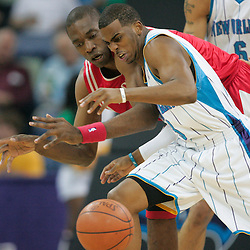 16 March 2009: New Orleans Hornets guard Chris Paul (3) scrambles for a loose ball with Houston Rockets center Dikembe Mutombo (55) during a NBA game between the New Orleans Hornets and the Houston Rockets at the New Orleans Arena in New Orleans, Louisiana.