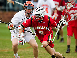Maryland Terrapins Midfielder Dan Groot (2) in defended by Virginia Cavaliers LSM Mike Timms (44).  The #9 ranked Maryland Terrapins fell to the #1 ranked Virginia Cavaliers 10 in 7 overtimes in Men's NCAA Lacrosse at Klockner Stadium on the Grounds of the University of Virginia in Charlottesville, VA on March 28, 2009.