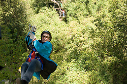 Chile, Lake Country: Canopying or ziplining adventure sport of sliding on a steel line through the canopy of the trees at Peulla.Photo #: ch624-33312..Photo copyright Lee Foster www.fostertravel.com, lee@fostertravel.com, 510-549-2202.