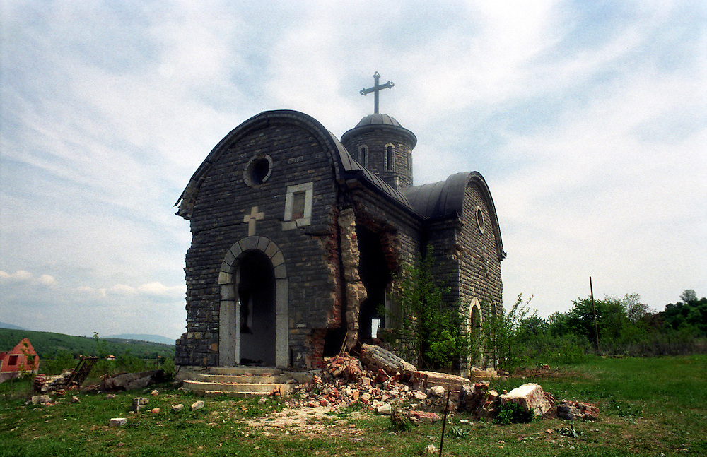 While the major holy sites have extensive Kfor protection nearly 100 smaller churches and holy sites have been desecrated and destroyed. This is the church in Osojane, which was mined twice but still stands. The international community have brought back the Serbs to Osojane, but the church is too damaged to be repaired. Osojane, Kosovo...Serbs living in enclaves in Kosovo.
