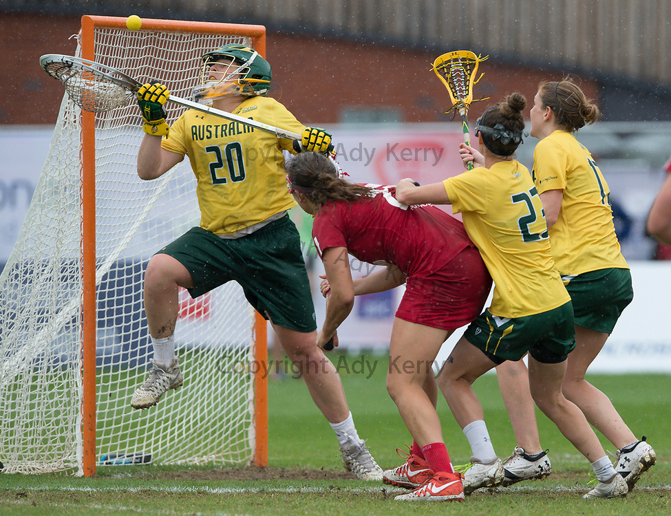 Australia's Elizabeth Hinkes saves from Olivia Hompe in the bronze medal match which England won with a Golden Goal in extra time at the 2017 FIL Rathbones Women's Lacrosse World Cup, at Surrey Sports Park, Guildford, Surrey, UK, 22nd July 2017.